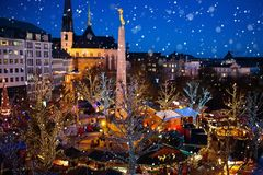 Christmas market. Winter fair with tree and lights. Christmas fair in Luxembourg. Aerial view of traditional Xmas market in old European city center. City Royalty Free Stock Photography