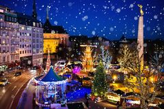 Christmas market. Winter fair with tree and lights. Stock Photos