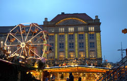 Christmas fairground attractions. Evening view of picturesque Christmas fairground with Ferris wheel Dresden,Germany Royalty Free Stock Photos