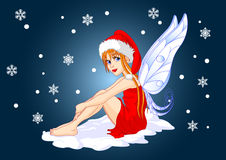 Christmas fairy. With Santa's hat sitting on the snow Stock Photos