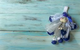 Christmas fairy on a blue old wooden background stock photography