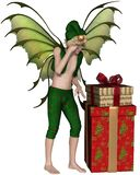 Christmas Fairy Elf Boy with Pile of Presents. Fantasy illustration of a Christmas fairy or elf boy standing with a pile of festive presents, 3d digitally Royalty Free Stock Photos