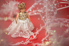 Christmas fairy. On a red background Stock Images