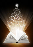Christmas fairy-tale. Vertical background with magic book Royalty Free Stock Images
