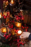 A Christmas fairy tale with candles and berries under the snow. Decor and gifts for Christmas. stock image