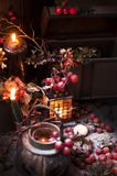 A Christmas fairy tale with candles and berries under the snow. Decor and gifts for Christmas royalty free stock photo