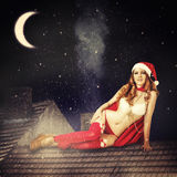 Christmas fairy woman  in red dress and santa hat Royalty Free Stock Image