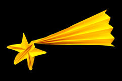 Christmas falling star. Christmas yellow falling star made of paper. Origami star Royalty Free Stock Photo