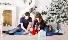 Christmas Family with baby opening gifts. Happy Stock Photography