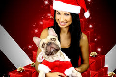 Christmas family. Beautiful young woman and his dog in christmas costume stock image