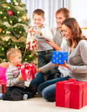 Christmas Family. Children Opening Gifts. Christmas tree Royalty Free Stock Images