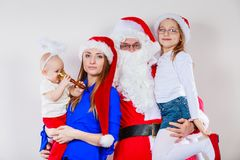 Mother, Santa and two daughters christmas family photo Stock Photography