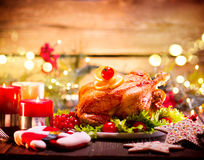 Christmas family dinner. Holiday decorated table with turkey. Christmas family dinner. Christmas holiday decorated table with turkey Royalty Free Stock Image
