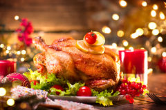 Christmas family dinner. Holiday decorated table with turkey. Christmas family dinner. Christmas holiday decorated table with turkey Royalty Free Stock Images