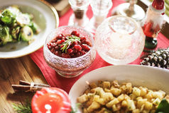 Christmas Family Dinner Table Concept. Close up of holiday food in bowls and plates Royalty Free Stock Photos