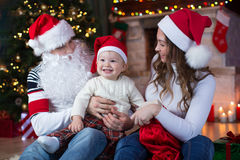 Christmas family in festive living room Stock Photography