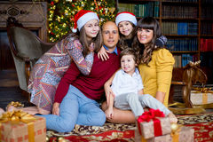 Christmas family of five people, happy parents and their kids. With gifts. Christmas and New Year interior stock images