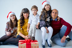 Christmas family of five people, isolated. Christmas family of five people, happy parents and their kids with gifts. isolated Stock Photo