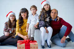Christmas family of five people, isolated. Christmas family of five people, happy parents and their kids with gifts. isolated Royalty Free Stock Images
