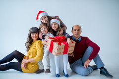 Christmas family of five people, isolated. Christmas family of five people, happy parents and their kids with gifts. isolated Stock Image