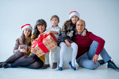 Christmas family of five people, isolated. Christmas family of five people, happy parents and their kids with gifts. isolated Royalty Free Stock Photos