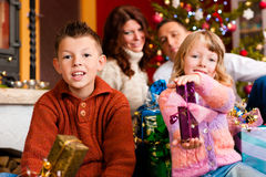 Christmas - family with gifts on Xmas Eve. Christmas - happy family (parents with son and daughter) with gifts on Xmas Eve royalty free stock photo