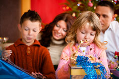Christmas - family with gifts on Xmas Eve. Christmas - happy family (parents with son and daughter) with gifts on Xmas Eve royalty free stock image