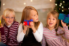Christmas and Family - Girls with presents Stock Images