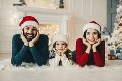Christmas family. Mom and dad and their little daughter together stock photo