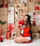 Christmas Family mother and baby toddler Kid on rustic craft pre Stock Images
