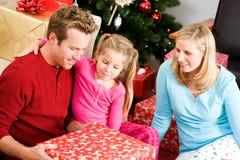 Christmas: Family Opening Christmas Presents Stock Image