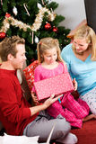 Christmas: Family Opening Christmas Presents Stock Images