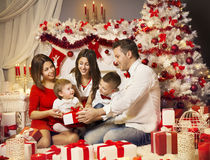 Christmas Family Opening Present Gift Box, Xmas Celebration Royalty Free Stock Images