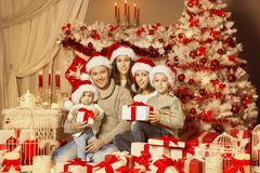 Christmas Family Portrait, Happy Father Mother and Children. Family with Presents Gifts under Xmas Tree Stock Photography