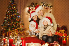 Christmas Family Portrait In Home Holiday Room, At Santa Hat Stock Photo