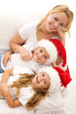 Christmas family relaxing on the sofa Royalty Free Stock Photography