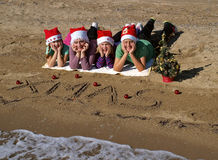 Christmas family on sand beach  Royalty Free Stock Photo