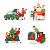 Christmas Family Scenes. Couple with Gift Boxes. Mother Bakes Christmas Cookies with Daughters. Parents with Children Decorating Fir. Boy and Girl near Royalty Free Stock Images