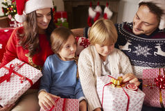 Christmas with family. Family sitting at home with Christmas presents Stock Image