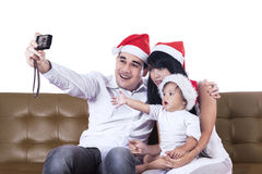 Christmas family take a photo Stock Photography