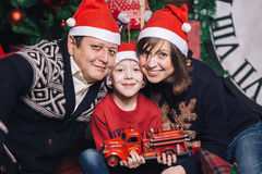Christmas family of three persons in red hats Royalty Free Stock Photo