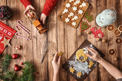 Christmas family traditions. Merry Christmas and Happy Holidays! Mother and daughter prepare Xmas cookies. Baubles, presents, candy and cookies with christmas Royalty Free Stock Photos