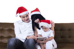 Christmas family using a tablet Royalty Free Stock Photo