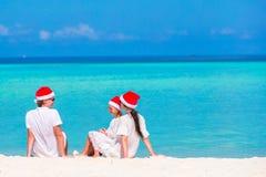 Christmas Family vacation on white beach Royalty Free Stock Photos