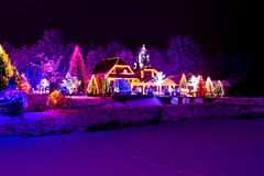 Christmas fantasy - park & lodge in xmas lights Royalty Free Stock Images