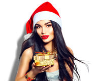 Christmas fashion model girl holding golden gift box Royalty Free Stock Image