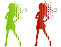 Christmas Fashion Silhouettes. A clip art illustration of your choice of 2 Christmas/Winter fashion model silhouettes in red and green with stripes isolated on Royalty Free Stock Images
