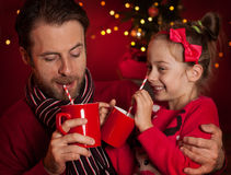 Christmas - father and daughter drink cocoa and having fun Royalty Free Stock Photography