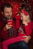 Christmas - father and daughter drink cocoa and having fun Stock Photography