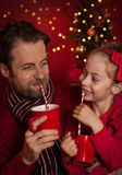 Christmas - father and daughter drink cocoa and having fun Stock Photo
